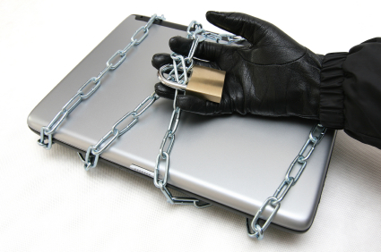 Thief attempting to break into a laptop computer wrapped in chains and secured with a padlock